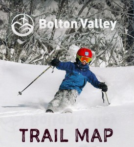 An image of Dylan skiing powder in the sunshine on the 2013-2014 alpine trail map for Bolton Valley Ski Resort in Vermont