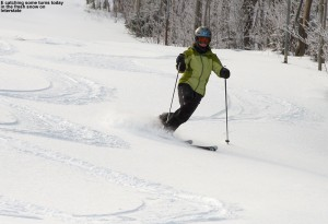 An image of Erica skiing a bit of powder on the Interstate trail at Jay Peak Resort in Vermont