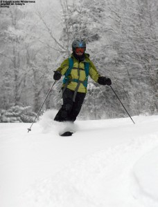 An image of Erica skiing powder snow on the Cougar trail at Bolton Valley Resort in Vermont
