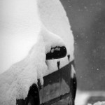 An image of a car covered in snow in the village at Bolton Valley Ski Resort in Vermont