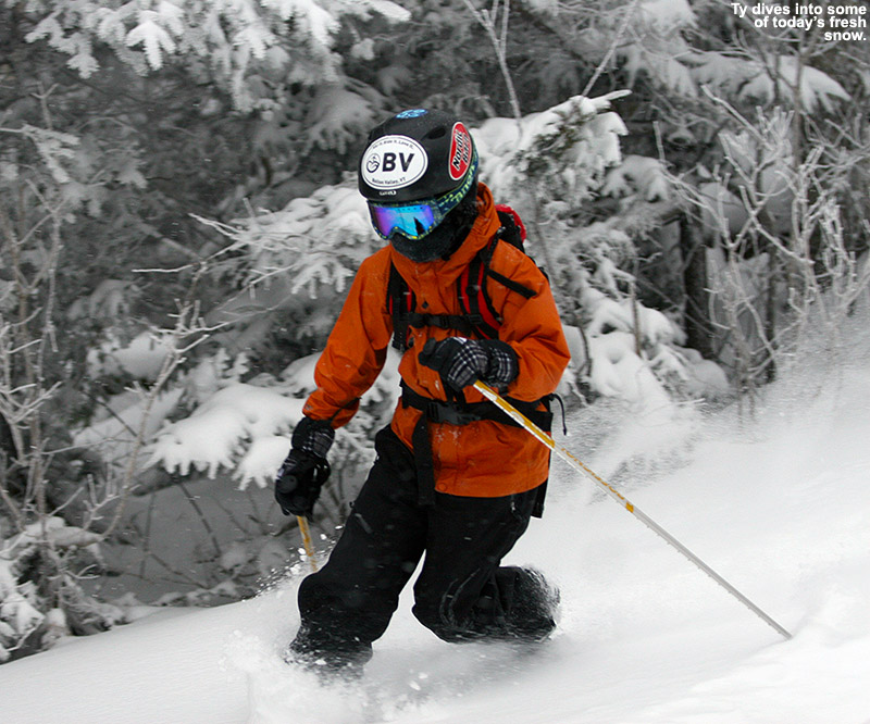 An image of Ty Telemark skiing in powder snow on the Cougar trail at Bolton Valley Resort in Vermont