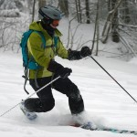An image of Erica Telemark skiing in a bit of lightly tracked powder on the Lower Turnpike trail at Bolton Valley Resort in Vermont