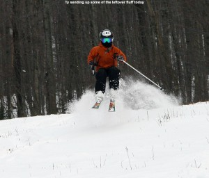 An image of Ty jumping in some powder snow on the Spell Binder trail at Bolton Valley Ski Resort in Vermont