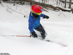An image of Dylan skiing powder along the edge of the Brandywine trail at Bolton Valley Ski Resort in Vermont