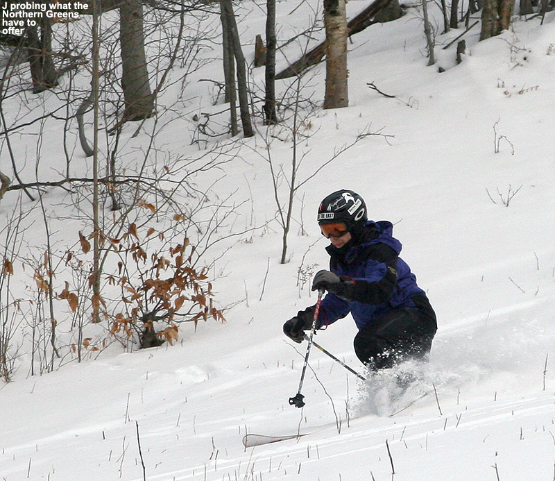 An image of Jay Telemark skiing in powder on the Spell Binder trail at Bolton Valley Resort in Northern Vermont