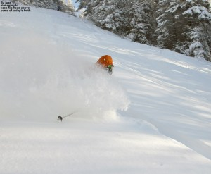 An image of Ty skiing deep powder on the Cougar trail at Bolton Valley Resort in Vermont