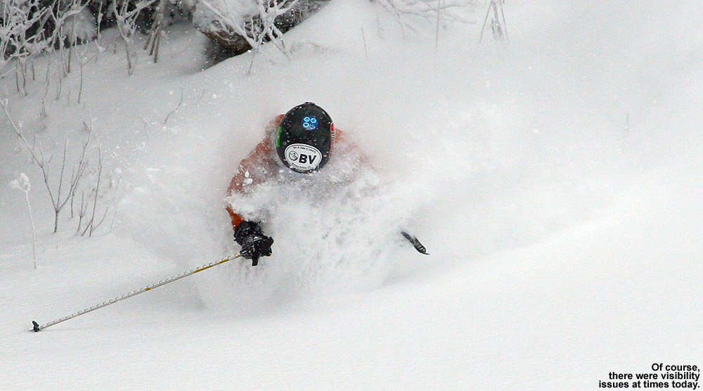 An image of Ty getting a face shot of powder on the Wilderness Lift Line trail at Bolton Valley Ski Resort in Vermont