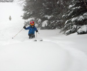 An image of Dylan skiing powder on the Wilderness Lift Line at Bolton Valley Resort in Vermont