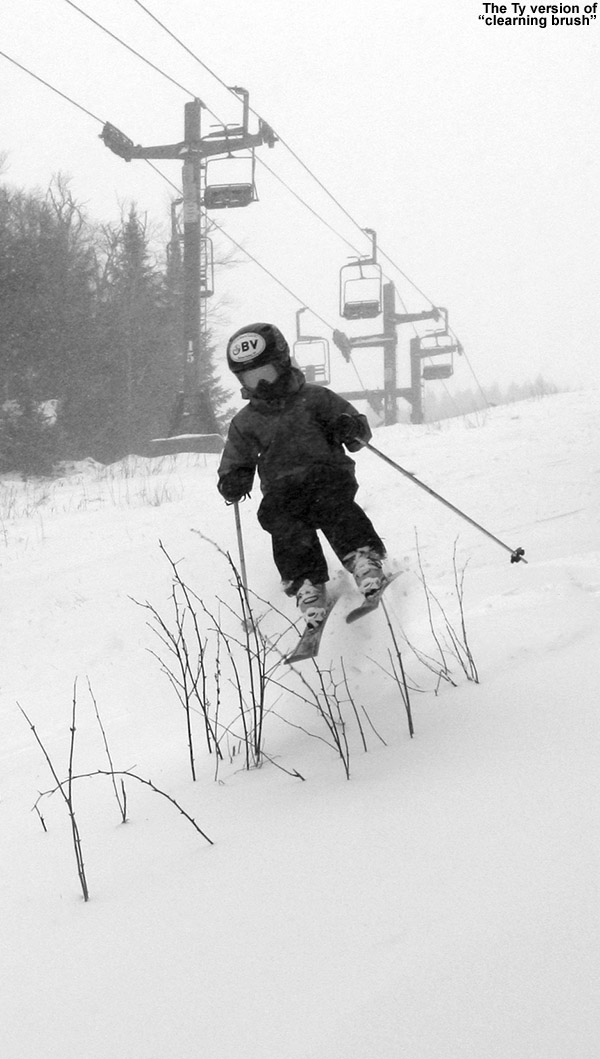 An image of Ty jumping over a clump of brush on the Wilderness Lift Line trail at Bolton Valley Ski Resort in Vermont