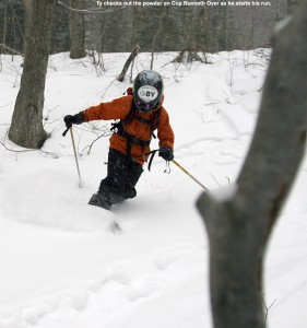 "An image of Ty making a Telemark turn in powder on the ""Cup Runneth Over"" glade in the backcountry skiing network at Bolton Valley Ski Resort in Vermont"