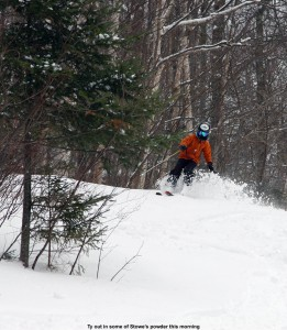 An image of Ty skiing powder on the Lower Tyro trail at Stowe Mountain Resort in Vermont