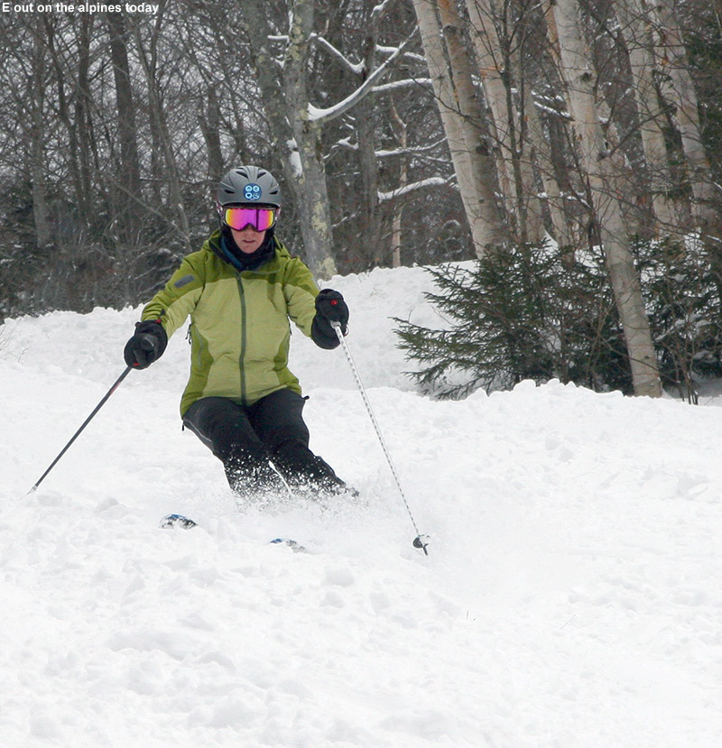 An image of Erica skiing soft snow on the Lower Tyro trail at Stowe Mountain Resort in Vermont