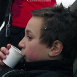 An image of Kenny drinking some hot chocolate after ski school program at Stowe Mountain Resort in Vermont