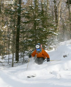 An image of Ty skiing powder in Maria's Woods at Bolton Valley Resort in Vermont