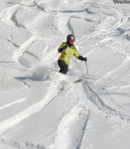 An image of E skiing some powder among ski tracks in the Wilderness are at Bolton Valley Resort in Vermont