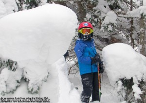 An image of Dylan between two pillows of powder snow on trees below the Kitchen Wall area at Stowe Mountain Resort in Vermont