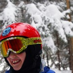 An image of Dylan smiling at the top of the Glades Right trail at Bolton Valley Ski Resort in Vermont