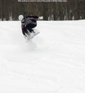 An image of Nikki doing a jump in powder at Bolton Valley Resort in Vermont