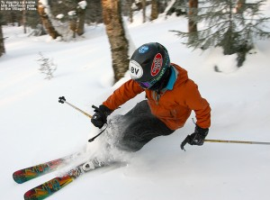 An image of Ty skiing powder in the Villager Trees area at Bolton Valley Resort in Vermont