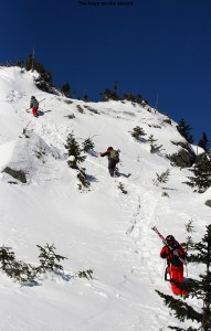 An image of Luc, Jack, and Kenny heading up the boot ladder in the Cliff Trail Gully on Mt. Mansfield above Stowe Mountain Ski Resort in Vermont