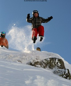 An image of Luc above Stowe Mountain Resort in Vermont jumping off the ridgeline of Mt. Mansfield into powder below
