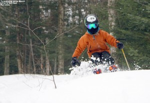 An image of Ty skiing some dense spring powder in the Deer Run area of Bolton Valley Ski Resort in Vermont