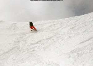 An image of Joe skiing Profanity Chute in the alpine terrain above treeline at Stowe Mountain Resort in Vermont