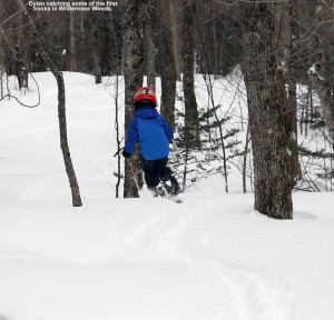 An image of Dylan skiing powder snow in the Wilderness Woods area of Bolton Valley Resort in Vermont
