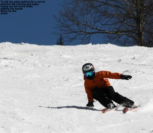 An image of Ty carving a turn with his had down on the spring snow at Bolton Valley Ski Resort in Vermont