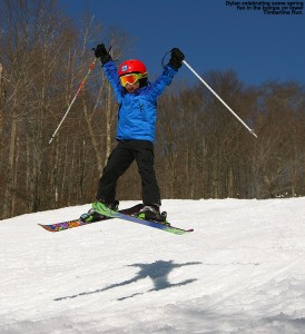 An image of Dylan jumping in the air on skis at Bolton Valley Ski Resort in Vermont