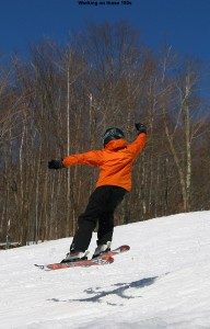 An image of Ty doing a 180 jump in spring snow at Bolton Valley Ski Resort in Vermont