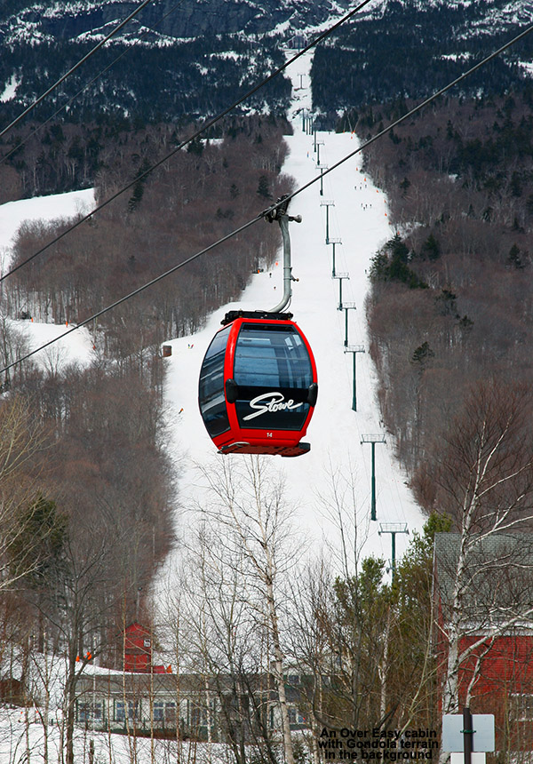 An image of the Over Easy Gondola at Stowe Mountain Ski Resort in Vermont with some of the Mt. Mansfield ski trails in the background