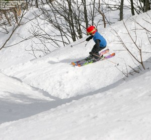 An image of Dylan skiing one of the chutes in Nosedive Bypass at Stowe