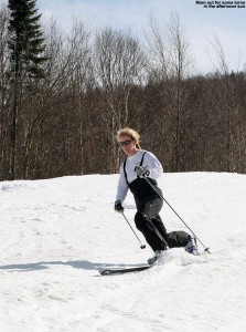An image of Erica Telemark skiing on the Interstate trail at Jay Peak Ski Resort over Mother's Day weekend 2014.