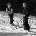 An image of Ty and Dylan on their skis during a descent of the North Slope trail at Stowe Mountain Resort in Vermont in mid May