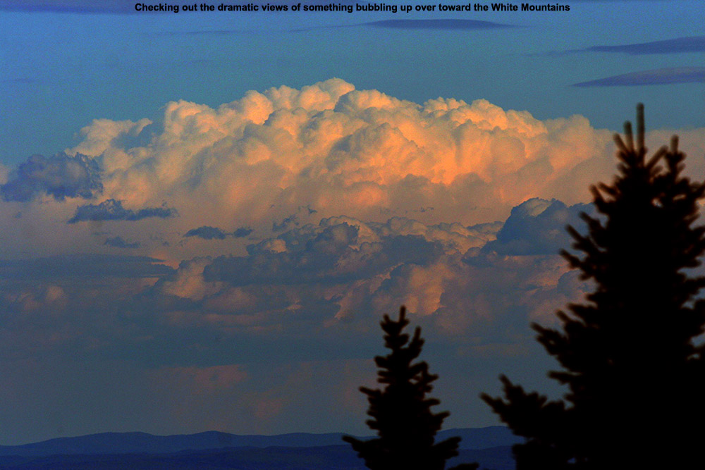 An image of thunderclouds off to the east in New Hampshire as viewed from near the Octagon summit building at Stowe Mountain Ski Resort in Vermont