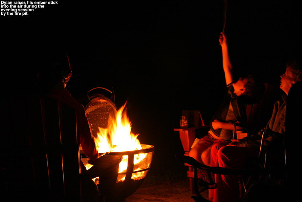 An image of Erica, Dylan, and Ty by the fire pit in Waterbury Vermont