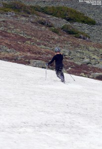An image of Erica skiing the snowfields on Mt Washington in New Hampshire in June