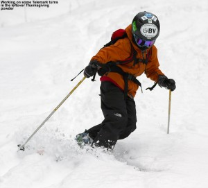 An image of Ty Telemark skiing in powder on the Old Turnpike trail at Bolton Valley
