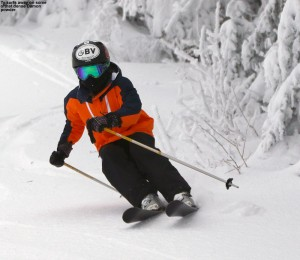 An image of Ty skiing dense snow left by Winter Storm Damon at Bolton Valley Resort in Vermont
