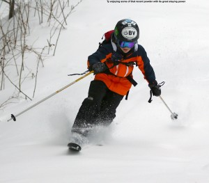 An image of Ty skiing powder on the Timberline Run trail at Bolton Valley Ski Resort in Vermont