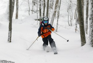 An image of Ty Telemark skiing in the Lost Boyz glade at Bolton Valley Ski Resort in Vermont