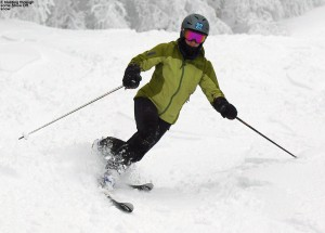 A picture of Erica skiing in fresh snow on the Show Off trail at Bolton Valley Ski Resort in Vermont
