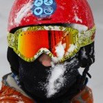 An image of Dylan with powder snow on his face and helmet at Bolton Valley Resort in Vermont