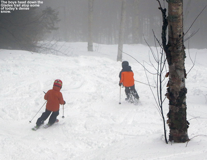 An image of Ty and Dylan skiing some dense snow on the Glades trail at Bolton Valley Ski Resort in Vermont