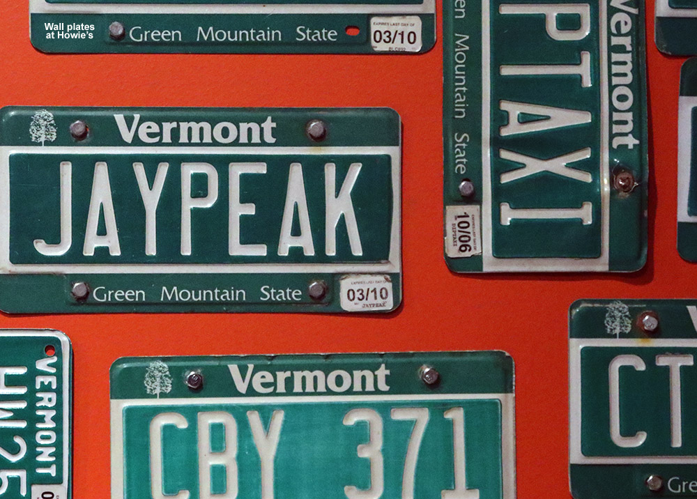 An image of Vermont license plates on the wall at Howie's restaurant at Jay Peak Resort