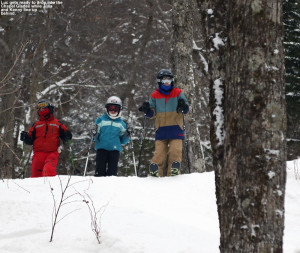 An image of Luc, Julia, and Kenny lining up to drop into the Chapel Glades area at Stowe Mountain Ski Resort in Vermont
