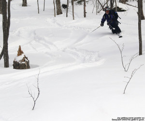 A picture of Jay skiing the Sasquash glade on the backcountry network at Bolton Valley Ski Resort in Vermont