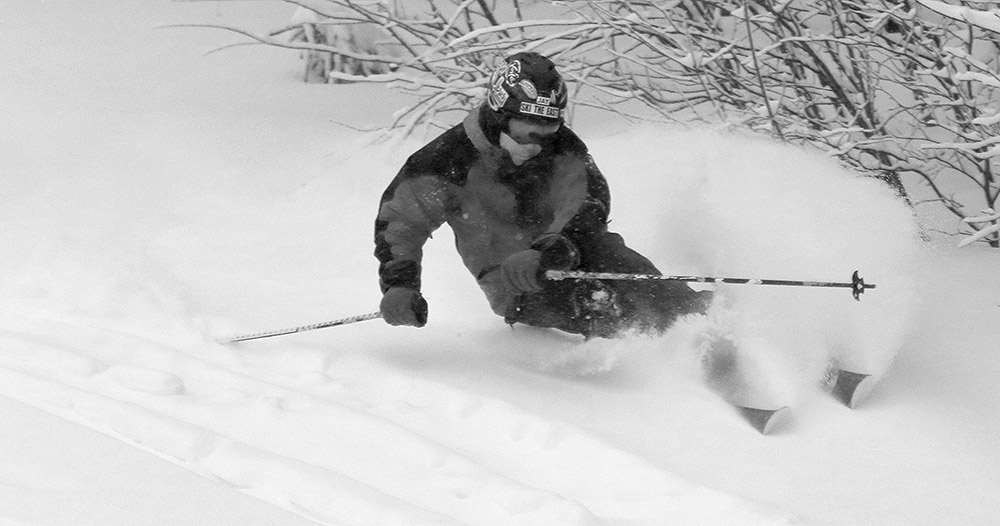 An image of Jay skiing along the edge of the Tattle Tale trail at Bolton Valley Ski Resort in Vermont