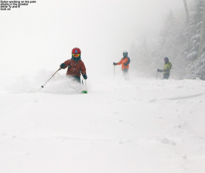 An image of Dylan skiing in powder snow on the Tattle Tale trail at Bolton Valley Ski Resort in Vermont